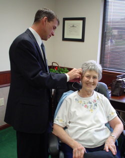 Al Wilson programming a patient's hearing aid